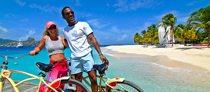 Couple with bicycles on the beach