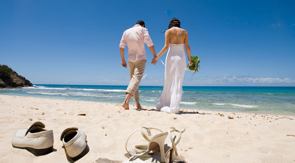 Couple on beach on wedding day