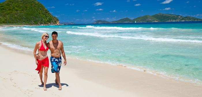 Young couple walking along a beach