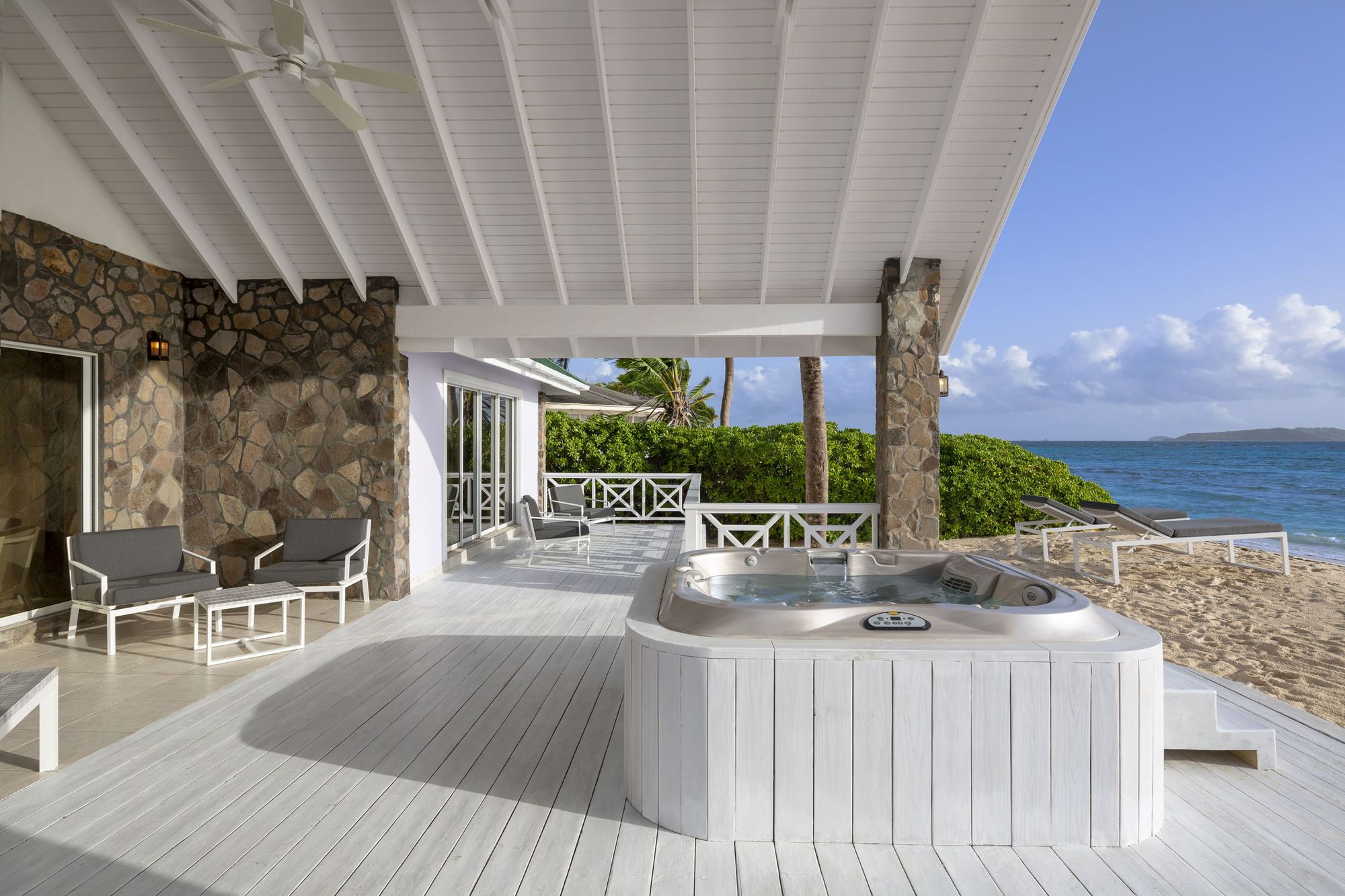 Seafeather patio at Palm Island Resort & Spa with hot tub on the beach