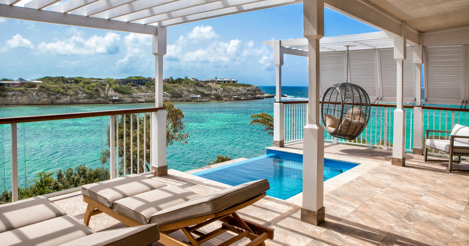 hammock cove infinity pool balcony with beach and sea view